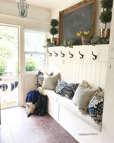 Beautiful entryway mud room bench with hooks and a shelf over it