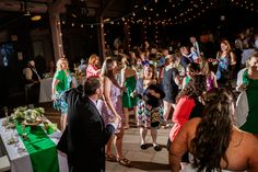 This dancing photo by Delumpa Photography perfectly captured the fun-lovng spirit of this wonderful family at their Happy Days Lodge wedding