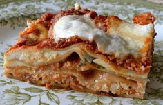 Lasagna Arrabbiata - Arrabiata , meaning angry, is a classic spicy hot Roman pasta sauce, and my version here is full of fiery chili pepper flakes, scorched roasted tomatoes, and garlic.  But this particular lasagna has a kinder, gentler side to it, made with delicate fresh sheets of pasta, ricotta scooped and drained just moments before baking, milky white shards of mozzarella so fresh it's impossible to slice, and basil leaves pinched and placed as needed right from the bouquet.