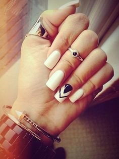 Edgy white nails with geometric black accent nail
