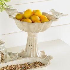 Birdbath with a ruffled rim and weathered white finish.   Product: BirdbathConstruction Material: MetalC...