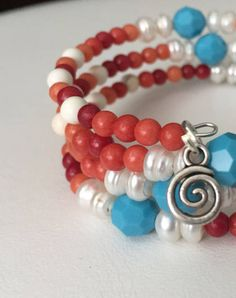 Tell us, just how far will you go to save the world? Moana sailed across the seas to save hers!  ********************************************  Hand made beaded wrap bracelet. Princess inspired/ Character inspired and great for all ages and wrist sizes! Red/beige, white, and swarvoski turquoise beads with silver swirl charm.  Perfect womens gift idea or girls gift idea! Show your character flair at the Disney Parks! Follow us on Instagram @hrhdesigns and like our page on Facebook @he...