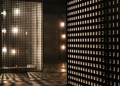 Lights projected through perforated boxes illuminated a space designed by Cullen Projects to host fashion shows during London Collections: Men.