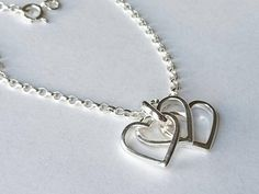 Check out this item in my Etsy shop https://www.etsy.com/uk/listing/535616674/sterling-silver-triple-heart-necklace