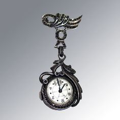 Deco Gotham Lapel Watch Sterling Silver Marcasite Brooch Pin / Nurses Mechanical Watch in Working Condition from Openslate Collectibles on Ruby Lane