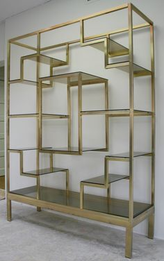 Italian Brass Etagere | From a unique collection of antique and modern shelves at http://www.1stdibs.com/furniture/storage-case-pieces/shelves/