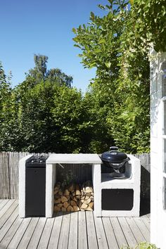 Selfmade outdoor kitchen with grill and storing for the wood.