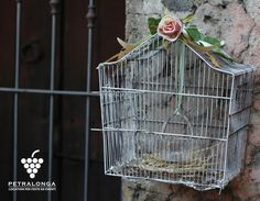 Old bird cage decorated  with candles and a handmade bird nest