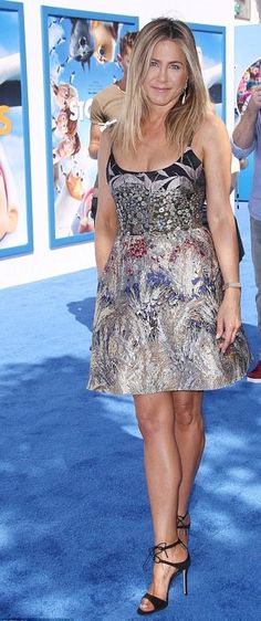 Jennifer Aniston hits the blue carpet while attending the premiere of her animated film Storks, in #valentino dress and #gianvitorosssi strap sandals! #celebstyleguide from @Celeb_StyleGuide's closet
