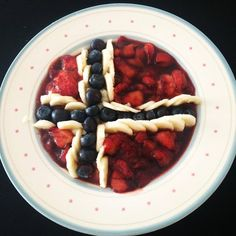 Risgrøt (Riceporridge) decorated with fruit creating the norwegian flag. Happy constitution day!!