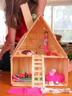 This is a great project for the kids!  A doll house made entirely from popsicle sticks!  Building the house is half the fun.  Decorating with scraps and found objects that are as unlimited a...