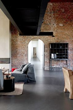Above: Neutral and rural is the melody of the six guestrooms at Factorij 10, a B & B housed in an old cigar factory.  Left: In the public areas have interior designer Dorien Cooreman has now stepped with red accents.