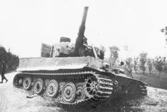 A abandoned Tiger 1 that has had the gun barrel put out of action with an explosive charge by American forces