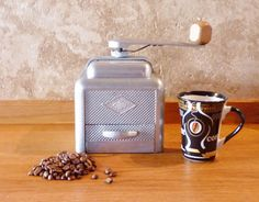 1950's French Moulux aluminium coffee grinder / by LeCrazyHorse