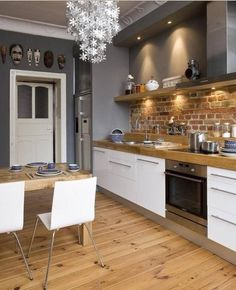 Uncover the Strong, Simple Beauty of Exposed Brick Wall Styles Backsteinmauer, offene Küche, Altbau, Open Kitchen, Kitchen Dining, Kitchen Decor, Kitchen Ideas, Kitchen Cabinets, White Cabinets, Room Kitchen, Brick Slips Kitchen, Wood Cabinets