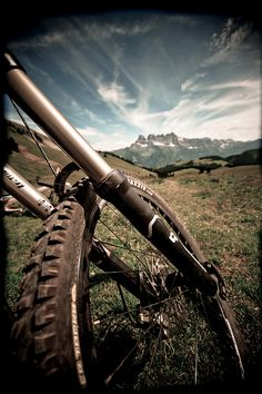 """It doesn't matter how slow you go, as long as you don't stop."" mountain biking. Les Dents du Midi in the back."