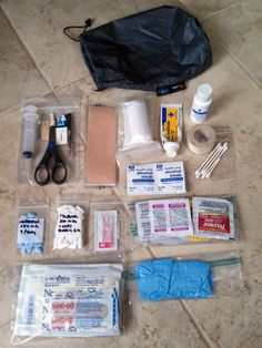 My updated, trimmed down, but still complete backpacking first aid kit.
