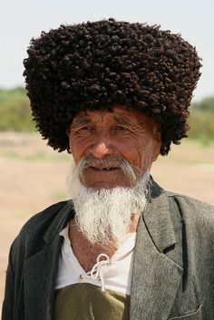 Turkman with typical headgear at Konue-Urgench.  Konye-Urgench in northern Turkmenistan is the site of the ancient town of Urgench, which contains the unexcavated ruins of the 12th-century capital of Khorezm. Since 2005, the ruins of Old Urgench ave been protected by UNESCO as a World Heritage Site. Fomerly situated on the Amu-Darya River, Old Urgench was one of the greatest cities on the Silk Road | Photo: Retlaw Snellac Photography  #world_cultures