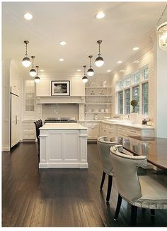 White Glass tile subway tile on walls and behind the stove: Found at http://www.subwaytileoutlet.com/