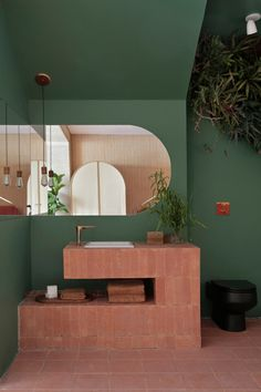 """Creamy brick walls and terracotta tiles feature in this São Paulo apartment by Melina Romano, which is intended to feel """"modern and bucolic"""". Hygge, Interior And Exterior, Interior Design, Design Interiors, Built In Furniture, Bathroom Inspiration, Bathroom Interior, Architecture, Sweet Home"""