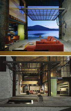 Concrete and wood lake house. Pivoting window.
