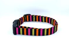 The striped collar to match any costume. This is not just a pattern for Halloween either... Pink, gold, orange, and black stripes Available in collars, bow-ties