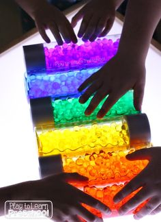 Dollar Store Rainbow Bottles for the Light Table Play to Learn Preschool: Rainbow Discovery Bottles Sensory Table, Sensory Bins, Sensory Activities, Preschool Activities, Sensory Boards, Sensory Play, Sensory Rooms, Infant Activities, Discovery Bottles