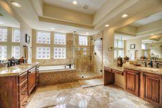 Master bathroom featuring dual vanities, travertine flooring and granite countertops. Travertine Floors, Granite Countertops, Corner Bathtub, Bath Ideas, Bathroom Ideas, Master Bathroom, My House, Bathrooms, Home Improvement