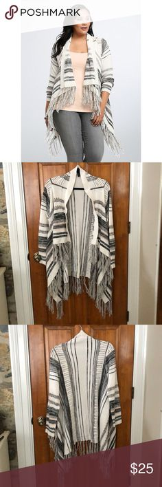 "NWOT Torrid Striped Fringe Open Front Sweater This gorgeous and cozy open front fringe sweater has been washed, but never worn. It's perfect to wear with leggings and skinny jeans!   Everyone's gonna be asking: ""where'd ya get that cardi?"" Soft ivory, grey and pink stripes vary in size and get a trendy boost thanks to open stitch details. The open front lets you show off your 'fit while a fringed hem lends a boho edge.    Size 1 measures 43"" from shoulder Acrylic/cotton Hand wash cold, dry…"