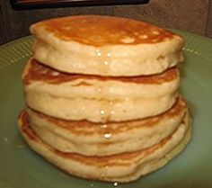 BEST PANCAKES EVER recipe ~ They are super tall, light and fluffy and yet they don't get all mushy when syrup is added, they are excellent!.