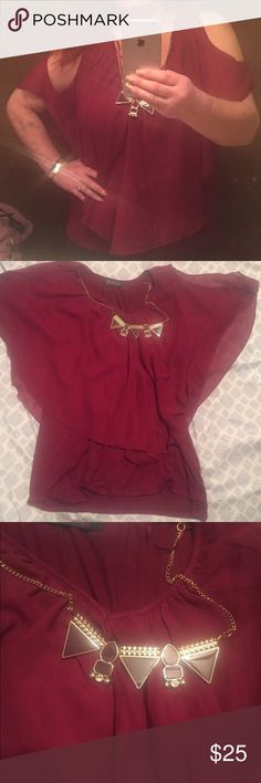 Maroon cold shoulder blouse Pretty maroon top with hardware attached around neck that is removable. Has cotton layer underneath upper ruffle. Absolutely darling. My closet is just over filled with tops this color. Was worn once and in perfect condition. All offers considered Tops Blouses