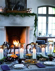 Tablescape and fireplace for Christmas.  Note dark blue napkins on textured, lighter blue (denim?) tablecloth.