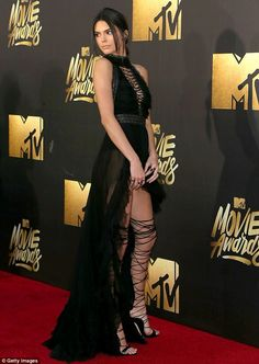 Killer heels! The Keeping Up With the Kardashians star wore thigh high strappy lace-up sti...