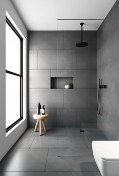 bathroom tiles Would you dare to go dark We love a dramatic space and this bathroom was created with our Evolution Matt Natural Grey tiles. Made from hard wearing porcelain they feature an authentic brushed stone effect finish . Grey Bathroom Tiles, Bathroom Tile Designs, Modern Bathroom Design, Bathroom Interior Design, Bathroom Flooring, Small Bathroom, Minimalist Bathroom Design, Shower Tiles, Large Tile Shower