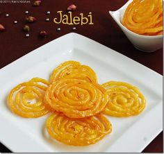 Recipe Of Jalebi . Jalebi is a spiral shaped crisp and juicy famous Indian sweet. It is also known as zulbia, jilapi etc. it is very easy to make recipe and specially served during festivals. Indian Desserts, Indian Sweets, Indian Dishes, Indian Food Recipes, Sweets Recipes, Cooking Recipes, Ramadan Recipes, Diwali Food, Yellow Foods