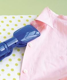 That straightening iron works on more than rambunctious hair:  Use it to press between buttons, where a regular iron won't fit.