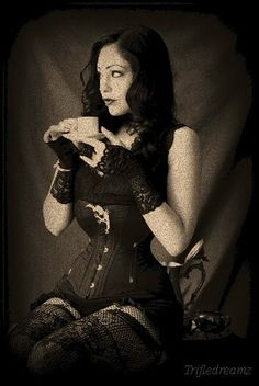 girl sipping tea in her corset