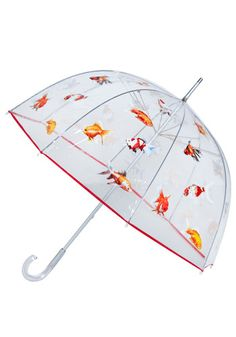 I had a clear bubble umbrella when I was a kid, but it wasn't this cool! I love the idea of pretty little fishies twirling about my head on a rainy day.
