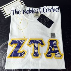 To Seek The Noblest Combo!! Brianne R. from VA, sure knew what she was doing when she put this adorable #ZetaTauAlpha shirt together! Here is what she selected: Comfort Colors Tee in White with Lilly Tide Pools Fabric on Maize Twill!  - - - #JennaBennaCo #ZTA #ZETA #GoGreek #SororityApparel #LOTD #lettersoftheday