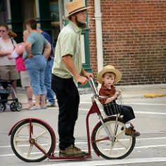 Amish father and son on a scooter