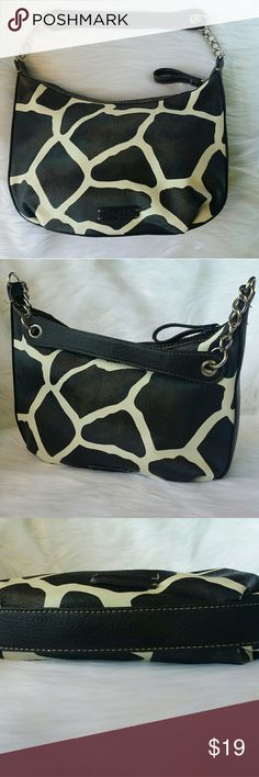 Nine & Co. Giraffe Print Shoulder Bag,  Purse Nine & Company by Nine West faux leather vinyl giraffe print handbag. In very good previously loved condition.  Short straps with chain links on the ends of the strap and handle make for an interesting detail.  Color is brown and white. The cover picture is the best representation of the brown. It measures 11 .5 wide by 7 in long  at the center. Inside has a zipper pocket on one side, a slip pocket on the other side. Non-smoking home.  Fun little…