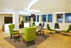 We love the way this business lounge uses bright  green as an accent colour to add vibrancy to the space.  #green #retro #office