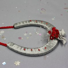 A custom designed horseshoe. Silver shoe to match the brides silver shoes! And gorgeous red roses to coordinate with the brides red bouquet. Horseshoes are a traditional wedding gift, given a modern make over by Lucky U gifts GB.  Click the link for more info and to get in touch. #wedding #weddinggift #giftideas #horseshoe #weddingkeepsake