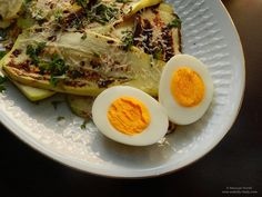 Salata calda de dovlecei la gratar.  Grilled courgette salad seasoned with parsley and grated Parmesan cheese.