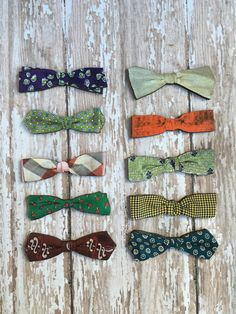 Cool vintage illustration on wood bowtie brooch. Listing is for one. The last photo shows the corresponding number for each tie. 2 3/4 inches wide.  Arrives in custom packaging ready for gift giving.  Thanks for stopping by!  Note: These beauties require a little extra care. I have soaked
