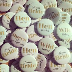 Gold text hen party badges available at thehenplanner.com the perfect accessory for the hen pArty guests and helps remember everyone's name for a mixed group! #hen #party #night #hens #bridal #shower #bachelorette #accessory #cool #unique #stylish #classy #alternative #chic #sophisticated #different #inspiration