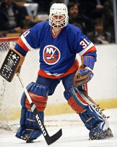 Canadian hockey player Billy Smith in the uniform of the New York Islanders, guards the net during a road game, Get premium, high resolution news photos at Getty Images Nhl Hockey Teams, Hockey Goalie, Hockey Games, Ice Hockey, Goalie Gear, Hockey Pictures, Sports Pictures, New York Islanders, Pittsburgh Penguins
