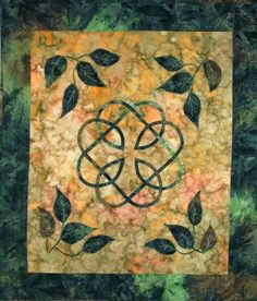 Traditional Book of Kells Celtic Knotwork with thread painted leaves and Celtic Cross, utilizing batik fabrics with channel quilted border❤️