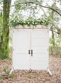 White ceremony wedding doors.  Enchanted wedding decor