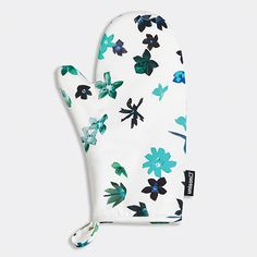 Floral Burst Turquoise Oven Mitt | Unison | Get a beautiful handle on everything sizzling in the kitchen, and do it in style with a sprinkling of petals in fresh-picked blues. Made from soft cotton sateen.
